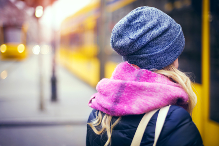 Girl in the tram stop Stock Photo