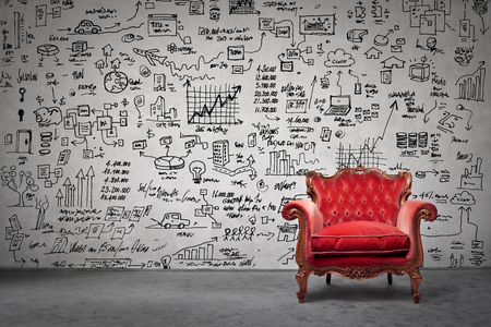 The red armchair and a lot of drawing on the wall Stock Photo