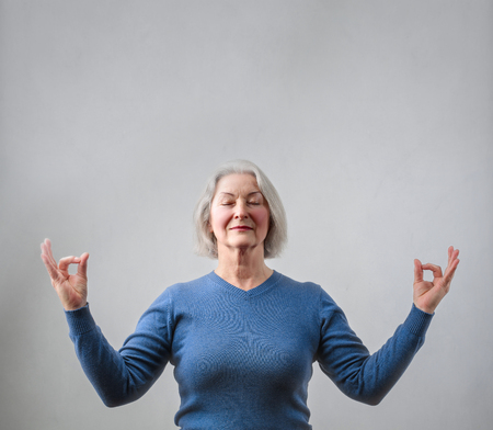 textured: Old lady is meditating Stock Photo