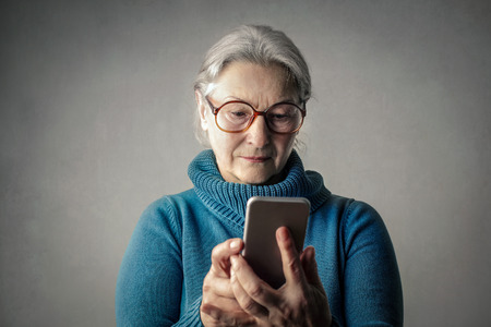 mobile: Old lady with her phone Stock Photo