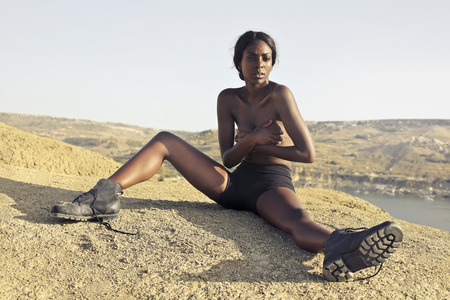 African lady on the rock Banque d'images