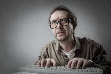 Man is typing on the keyboard Stock Photo