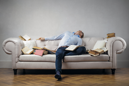 Sleeping with books on the sofa