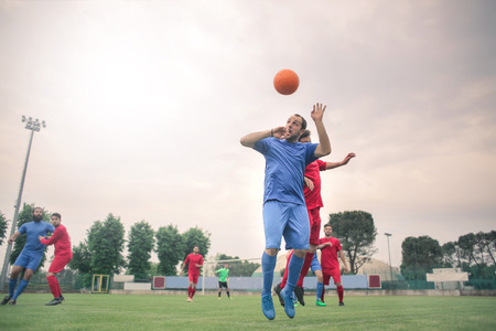 Playing football on the field photo