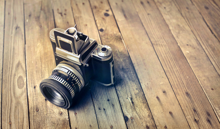 Old camera on the floor Stock Photo