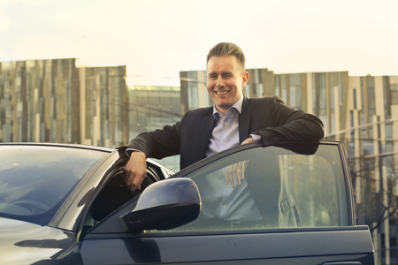 profession: Businessman with his car