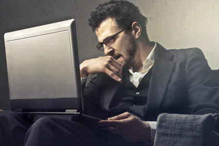 Businessman with his laptop photo