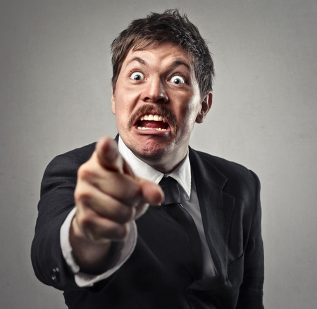 Angry businessman is pointing at you Stock Photo
