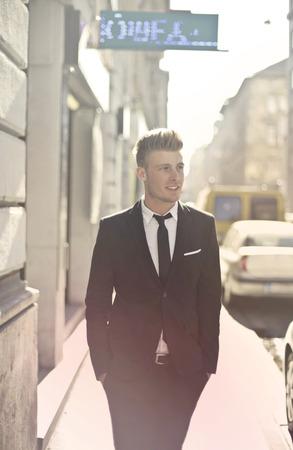 Businessman is walking on the street photo