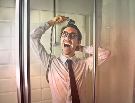 Man in his shirt in the shower