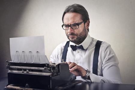 Man is using a typewriter