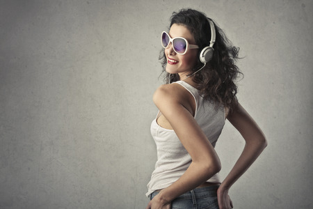 Woman is listening to music photo