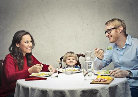 Happy family at dinner photo