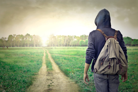 A traveler in a black hood photo