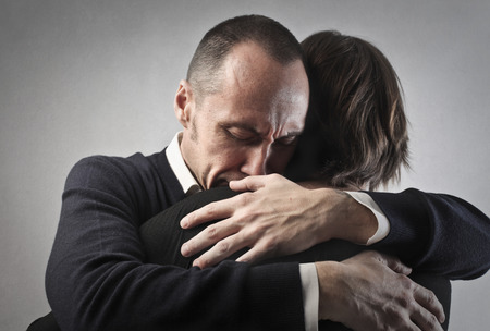 Businessmen are hugging photo