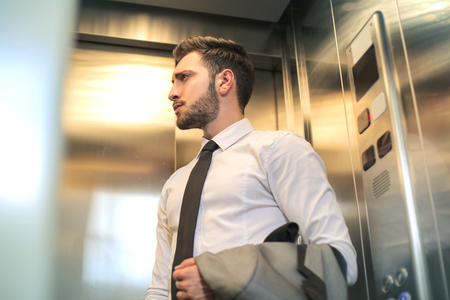 working attire: Businessman in the elevator