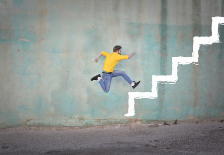 Man is climbing up stairs on