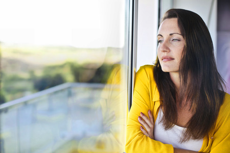 face to face: Woman is also waiting in the window