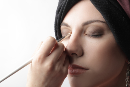 Preparing the model's make-up photo
