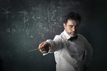 Professor is teaching mathematics Stock fotó