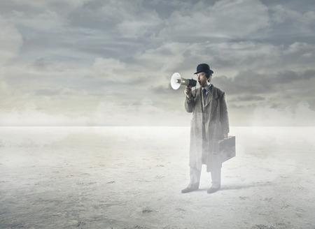 Businessman in the desert Stock Photo