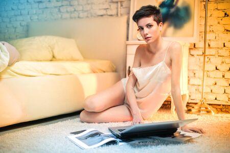 pretty woman on the floor photo
