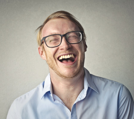 Happy businessman in glasses photo