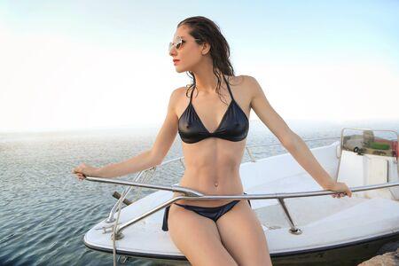 Woman in bikini on a boat