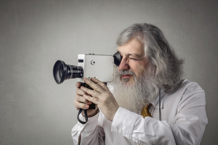 Old man with an old filmmaker photo