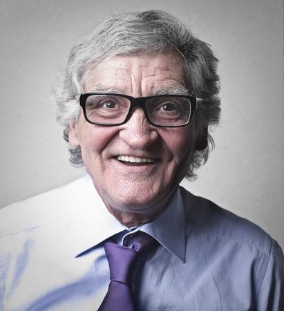 Smiling old man in glasses