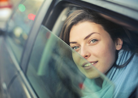 face to face: Pretty girl with blue eyes is traveling in a car