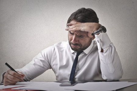 Businessman is about to cry Because of his work Imagens
