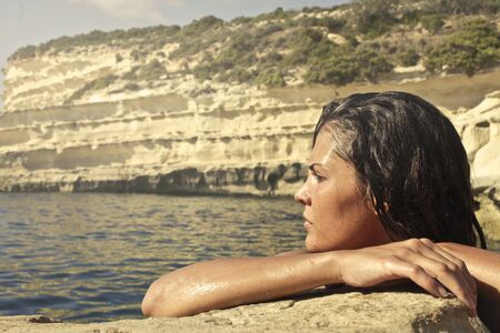 Woman is watching the beautiful blue water