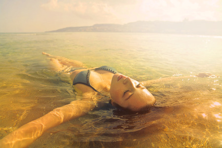 Woman is relaxing in the water Stock Photo
