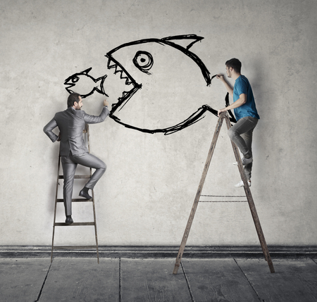 Men are drawing fish on the wall photo