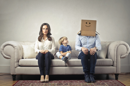box: The mum and son, and a father with a boy on his head Stock Photo