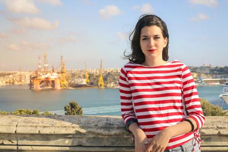 fashion: Woman at the Harbor of malta Stock Photo