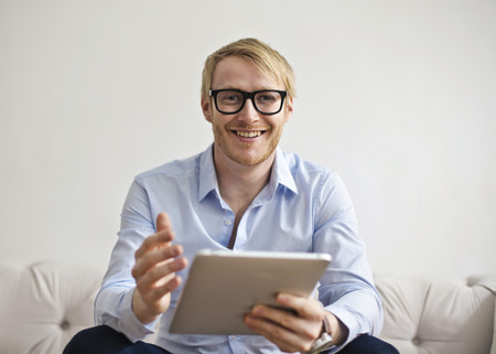 work: Smiling guy with his tablet