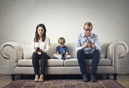 The boring family with Their phones Foto de archivo