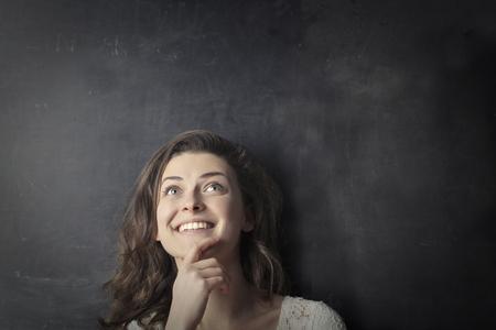 黒板の前で思考の女の子 写真素材