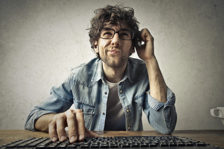 Young nerd thinking too hard Stock Photo