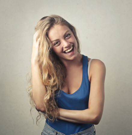 long: Young girl with long hair is laughing Stock Photo