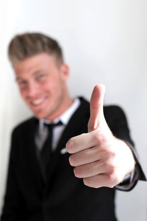 Young businessman Shows a thumb up