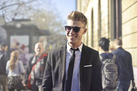 Handsome young businessman in the crowd photo