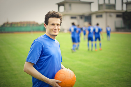 The soccer player on the football field photo