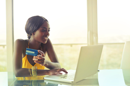 Black woman is shopping on the Internet