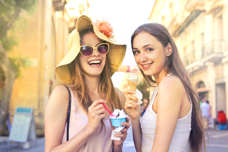 Happy girls are eating ice cream Stock Photo