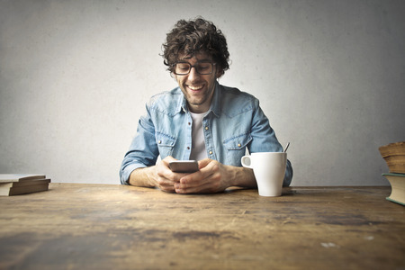Drinking coffee and using a smart phone
