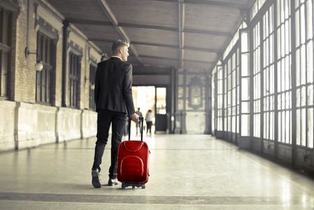 profession: Businessman is traveling with a suitcase Stock Photo