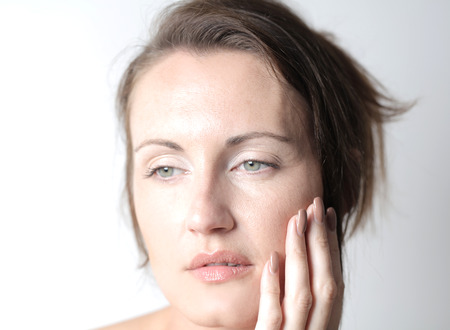 Adult woman is taking care about her skin photo